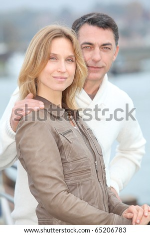 Closeup of relaxed couple in town - stock photo