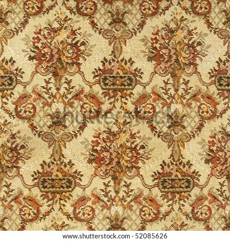 Closeup of retro exquisite tapestry fabric pattern with classical  floral wall-paper ornament in  beige-brown tones on light background . - stock photo