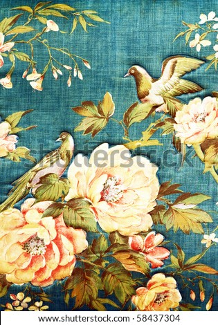 Closeup of retro tapestry fabric pattern with classical image of the colorful  flowers and birds on blue background. - stock photo
