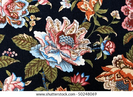 Closeup of retro tapestry fabric pattern with colorful  floral ornament with dark background. - stock photo