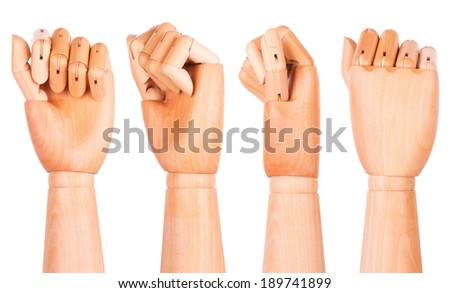 Closeup of right wooden hand - clenched fist, isolated over white background - stock photo