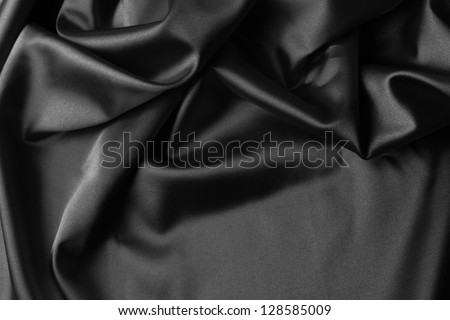 Closeup of rippled black silk fabric - stock photo