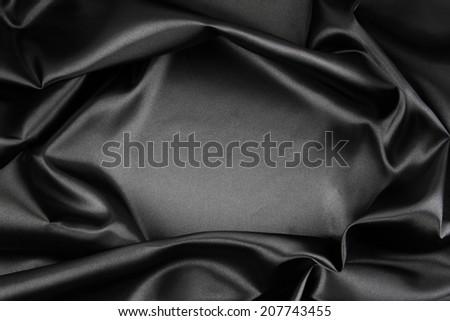 Closeup of rippled black silk fabric - stock photo