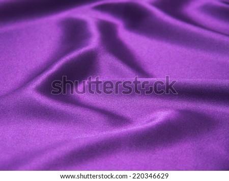Closeup of rippled purple satin fabric - stock photo