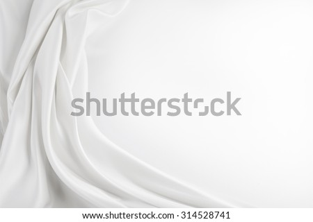 Closeup of rippled white silk fabric - stock photo