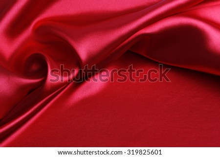 Closeup of ripples in red silk fabric - stock photo
