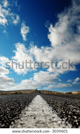 Closeup of Road Line on a hot summer day - stock photo