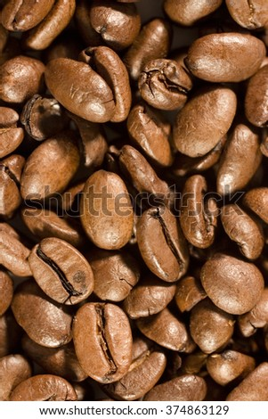 Closeup of roasted coffee beans (as a background, shallow DOF)