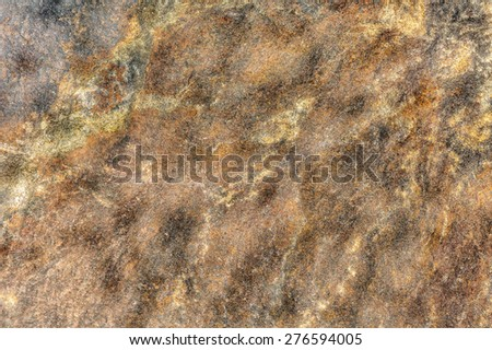 Closeup of rough stony texture as background - stock photo