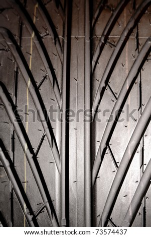Closeup of rubber tire tread - stock photo