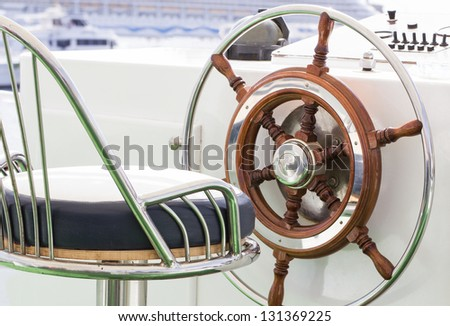 Closeup of rudder and chair in a luxury boat. - stock photo