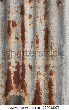 Closeup of rusty galvanized iron wall plate /  corrugated sheet texture. - stock photo