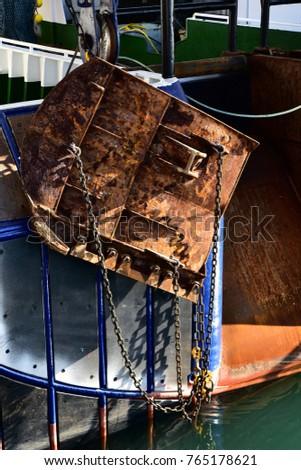 Closeup of rusty trawl door on the stern of a Trawler fishing boat. Vertical view & Closeup Rusty Trawl Door On Stern Stock Photo 765178621 - Shutterstock