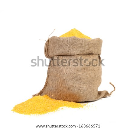 Closeup of sack with corn flour. Isolated on a white background. - stock photo