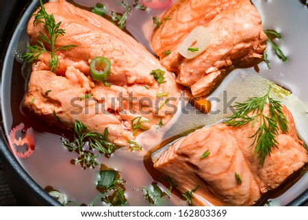 Closeup of salmon soup spiced with dill and chives - stock photo
