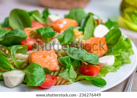Closeup of salmon with vegetables and lettuce - stock photo