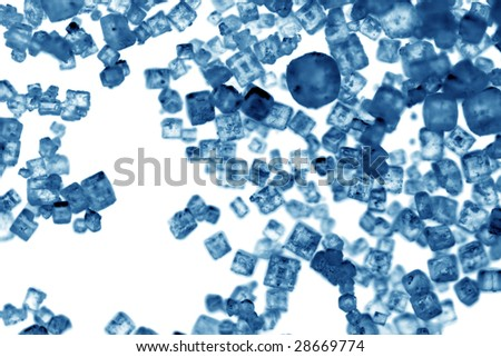 Closeup of salt crystals isolated on white backgrouns - stock photo