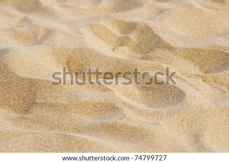 closeup of sand of a beach in the summer - stock photo