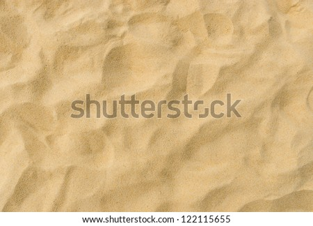 closeup of sand pattern of a beach in the summer - stock photo