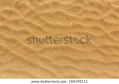 closeup of sand pattern of a beach in the summer thailand