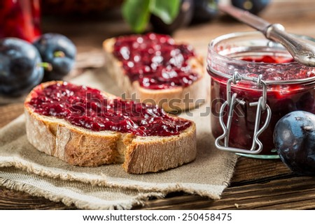 Closeup of sandwich with fresh plum jam - stock photo