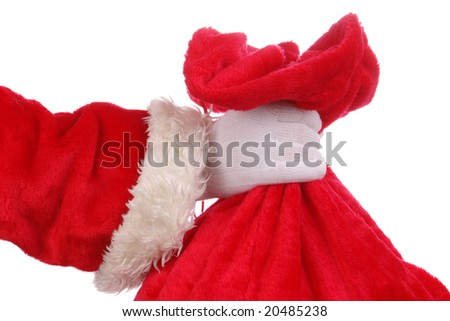 Closeup of Santa Claus hand holding red sack full of presents over white background - stock photo