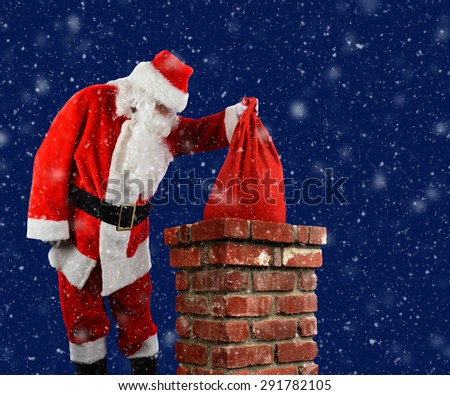 Closeup of Santa Claus placing his bag of toys into a chimney on a snowy Christmas Eve.