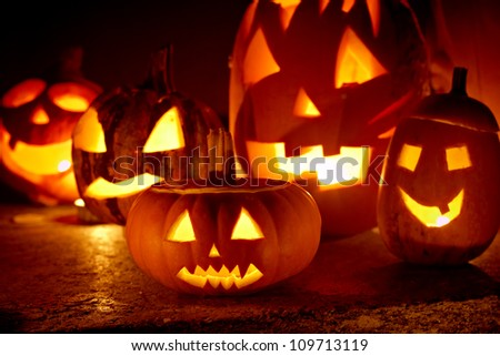 closeup of scary halloween pumpkins - stock photo