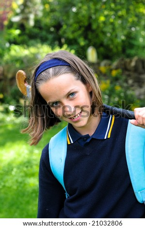 closeup of school girl carrying hockey stick - stock photo