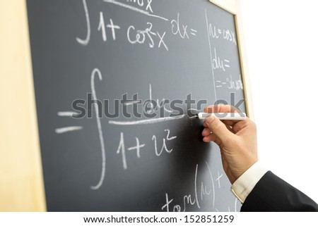 Closeup of scientist calculating complex mathematical equation on black board. - stock photo