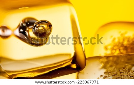 closeup of scotch whiskey in glass with ice cubes, background concept - stock photo