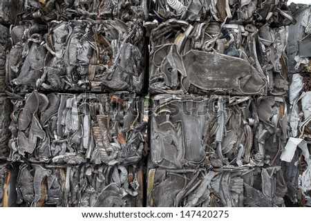 Closeup of scrap metal bales bundled for recycling