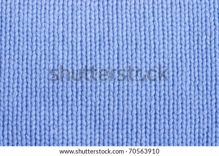 closeup of seamless blue knitted fabric texture - stock photo