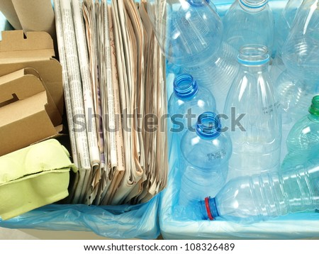 Closeup of segregated plastic and paper waste - stock photo