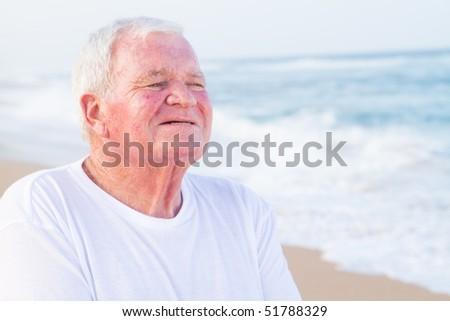 closeup of senior citizen man on beach - stock photo