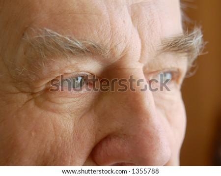 Closeup of senior man eyes - stock photo