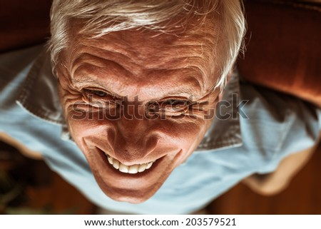 Closeup of senior man face toothy laugh - stock photo