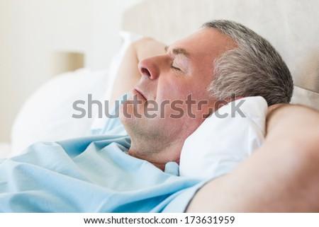 Closeup of senior man sleeping in bed at home - stock photo