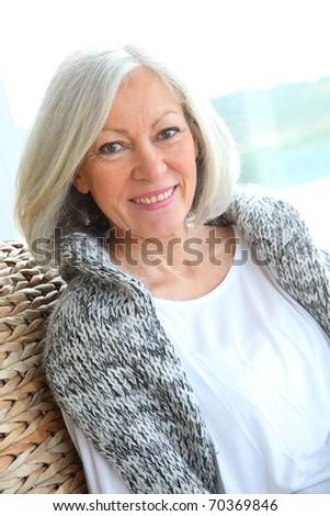 Closeup of senior woman relaxing at home - stock photo