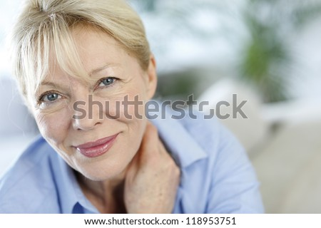 Closeup of senior woman with blue shirt - stock photo