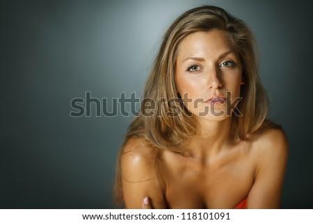 Closeup of sensual beautiful woman over dark background - stock photo