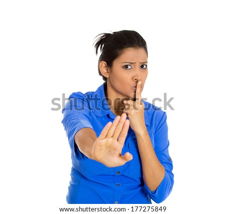 Closeup of serious woman placing finger on lips, pointing at you as if to say, shhhhh, quiet, silence , isolated on white background. Human face expressions, signs, emotions, feelings, body language - stock photo