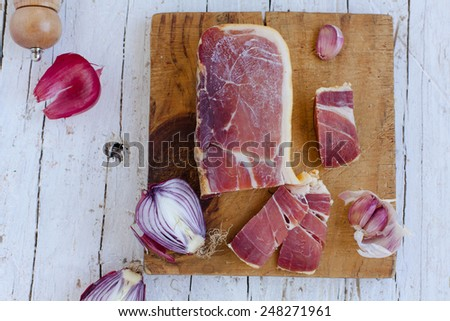Closeup of serrano ham. Traditional Spanish tapas. Natural meat concept. - stock photo