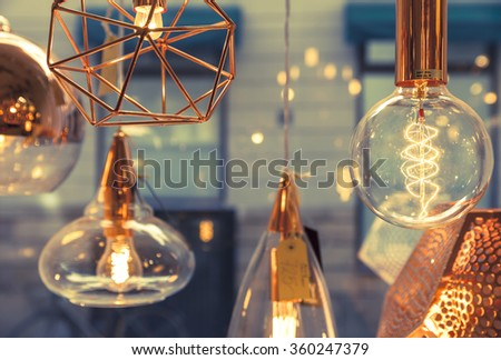 Closeup of several bulbs seeing their tungsten filaments - stock photo
