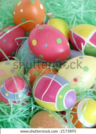 Closeup of several Easter eggs over green artifial grass. - stock photo