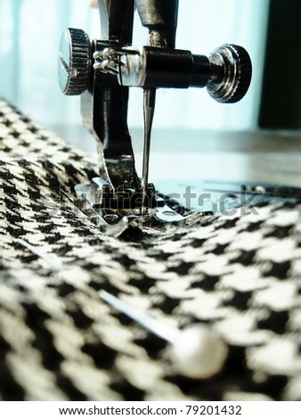 Closeup of sewing machine and fabric