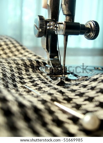 Closeup of sewing machine and fabric with pin - stock photo