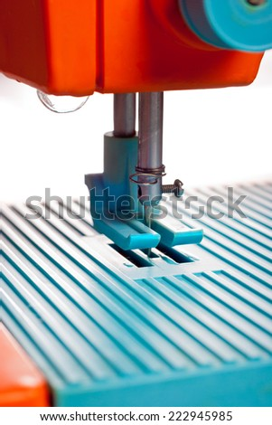 Closeup of sewing machine working part with needle - stock photo