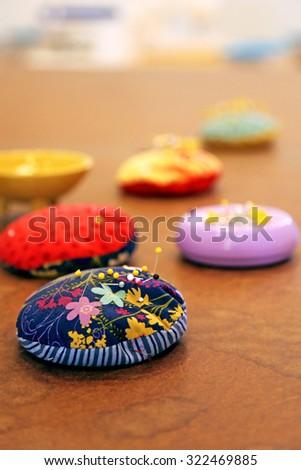 Closeup of sewing pin cushions - stock photo