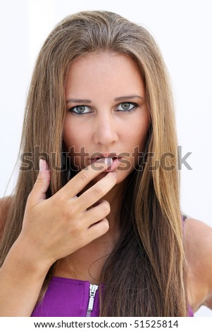 closeup of sexy female face with finger in mouth - stock photo